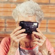 assisted living community, elderly woman taking a picture