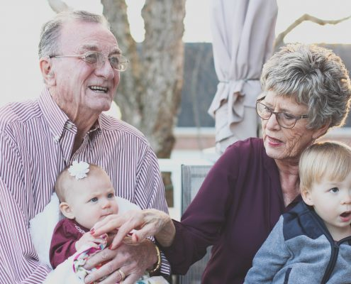 what is independent living, grandparents holding baby and small child